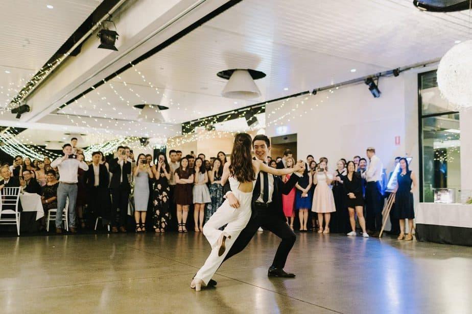 millennial couple dancing on wedding venue floor
